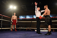 Zak Chelli (red shorts) defeats Ladislav Nemeth at the Woodside Leisure Centre on 9th March 2019