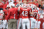 MADISON, WI - SEPTEMBER 9: The Wisconsin Badgers huddle during warmups prior to the game against the Western Illinois Leathernecks at Camp Randall Stadium on September 9, 2006 in Madison, Wisconsin. The Badgers beat the Leathernecks 34-10. (Photo by David Stluka)