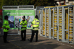 © Joel Goodman - 07973 332324 . No syndication permitted . 28/09/2013 . Manchester , UK . Police guard turnstiles from within the secure zone roads around the conference venue and erect a ring of steel to secure the venue . Preparations ahead of the Conservative Party annual conference in Manchester , today (Saturday 28th September 2013) . Photo credit : Joel Goodman
