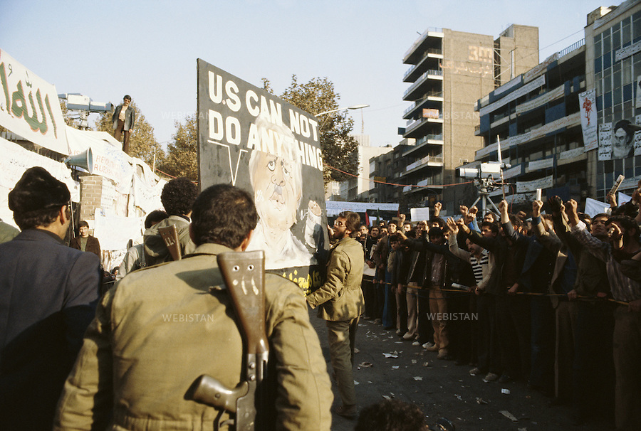 TEHRAN, IRAN - DECEMBER 1979: A demonstration during the hostage crisis at the U.S. embassy which was a diplomatic crisis between Iran and the United States where 52 U.S. diplomats were held hostage for 444 days from November 4, 1979 to January 20, 1981, after a group of Islamist students took over the American embassy in support of the Iranian revolution. (Photo by Reza/Webistan).<br /> T&eacute;h&eacute;ran, Iran - d&eacute;cembre 1979 : une manifestation pendant la crise des otages &agrave; l'ambassade des Etats Unis &agrave; T&eacute;h&eacute;ran. La crise des otages &agrave; T&eacute;h&eacute;ran fut une crise diplomatique entre l'Iran et les Etats Unies durant laquelle 52 diplomates am&eacute;ricains furent pris en otage par un groupe d'&eacute;tudiants islamistes apr&egrave;s qu'ils se soient empar&eacute;s de  l'ambassade am&eacute;ricaine dans le cadre de leur soutien &agrave; la r&eacute;volution islamique. Les otages rest&egrave;rent  prisonniers pendant 444 jours du 4 novembre 1979 au 20 janvier 1981 (Photo de Reza/Webistan).