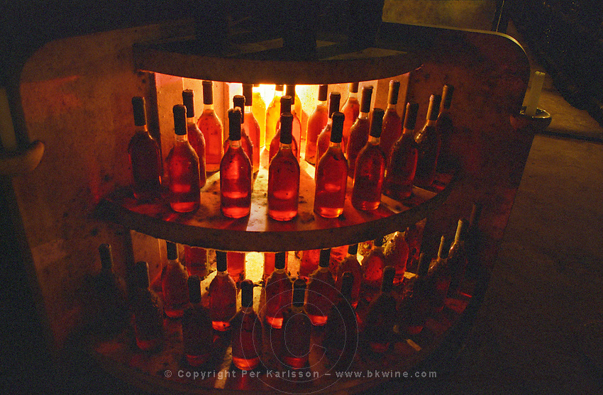 Oremus winery in Tolcsva, Tokaj: The underground cellar carved in the volcanic rock with long tunnels. A corner decorated with bottles with golden Tokaj wine. Oremus is owned by the Alvarez family that also owns Vega Sicilia in Spain It is managed by Andras Bacso. Credit Per Karlsson BKWine.com