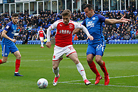 Conor McAleny of Fleetwood Town takes on Steven Taylor of Peterborough United during the Sky Bet League 1 match between Peterborough and Fleetwood Town at London Road, Peterborough, England on 28 April 2018. Photo by Carlton Myrie.