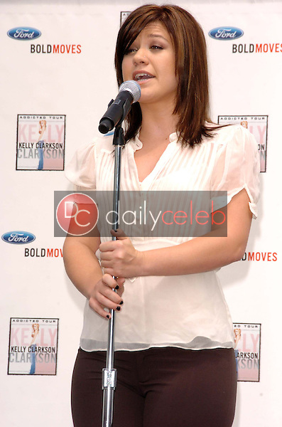 """Kelly Clarkson<br />at a press conference to announce Ford new marketing campaign """"Bold Moves"""". Galpin Ford, North Hills, CA. 05-02-06<br />Scott Kirkland/DailyCeleb.Com 818-249-4998"""