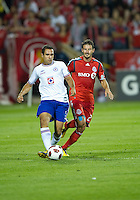 17 August 2010:  Toronto FC midfielder Martin Saric #25 and Cruz Azul Alejandro Castro #5 in action during a CONCACAF Champions League group stage game between Cruz Azul and Toronto FC at BMO Field in Toronto..Toronto FC won 2-1.....