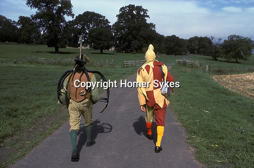 Abbots Bromley Horn dance. Staffordshire. The Fool and one of the dancers. UK. September