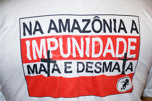 "Rio Negro, Brazil. T-shirt ""In Amazonia Impunity kills and deforests."""