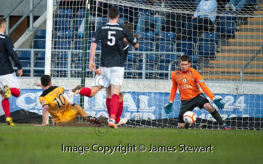 Dumbarton's Garry Fleming  scores their second goal.