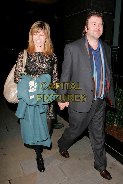 KATE GARRAWAY & DEREK DRAPER.At Embassy nightclub, London, England..November 11th, 2008.full length grey gray suit holding hands married husband wife black lace dress holding hands carrying green jacket coat beige bag purse.CAP/AH.©Adam Houghton/Capital Pictures.