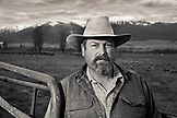 USA, Oregon, Enterprise, Portrait of Cowboy and Rancher Todd Nash at a ranch in North East Oregon between Enterprise and Joseph, looking towards the Eagle Cap Wilderness and the Wallowa Mountains, Wallowa-Whitman National Forest