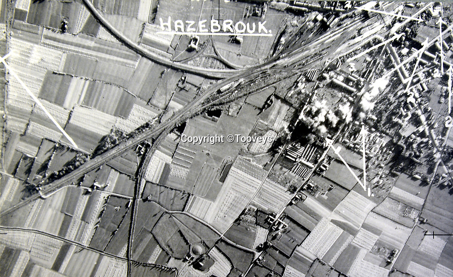 BNPS.co.uk (01202 558833)<br /> Pic:  Tooveys/BNPS<br /> <br /> Taken on 19/08/41 - An attack on the marshalling yard at Hazebrouk in northern France.<br /> <br /> Dramatic photos showing a series of heart-pounding World War Two bombing raids from the pilot's perspective have come to light.<br /> <br /> They were taken from Blenheim bombers undertaking attacks on targets in Germany and Nazi-occupied Netherlands in 1941.<br /> <br /> Several capture the immediate aftermath of a direct hit, with flames and clouds of smoke signifying they had achieved their aim.<br /> <br /> The album, which contains almost 100 photos, has emerged for sale with Toovey's Auctions, of Washington, west Sussex.