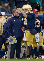 Head coach Brian Kelly and quarterback Tommy Rees (11) talk on the sideline.