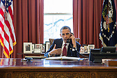 United States President Barack Obama talks on the phone with Nicole Hockley and families of the victims of the Sandy Hook Elementary School shootings in Newtown, Conn., in the Oval Office, April 11, 2013. .Mandatory Credit: Pete Souza - White House via CNP