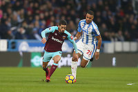 West Ham United's Manuel Lanzini and Huddersfield Town's Mathias Zanka Jorgensen<br /> <br /> Photographer Rob Newell/CameraSport<br /> <br /> The Premier League - Huddersfield Town v West Ham United - Saturday 13th January 2018 - John Smith's Stadium - Huddersfield<br /> <br /> World Copyright &copy; 2018 CameraSport. All rights reserved. 43 Linden Ave. Countesthorpe. Leicester. England. LE8 5PG - Tel: +44 (0) 116 277 4147 - admin@camerasport.com - www.camerasport.com