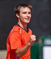 August 9, 2014, Netherlands, Rotterdam, TV Victoria, Tennis, National Junior Championships, NJK,  Guy den Heijer (NED) wins boys 18 final and celebratesw<br /> Photo: Tennisimages/Henk Koster