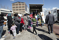 Pictured: Migrants queue for hand outs Thursday 03 March 2016<br />