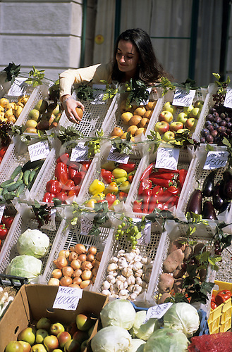 Bucharest, Romania. Street market stall with fresh produce; apples, pears, plums, tomatoes, courgettes, aubergines, peppers, cabbage, onions, garlic, potatoes.