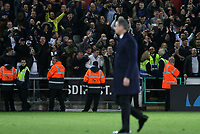Swansea City manager Paul Clement leaves the field as the traveling Tottenham fans celebrates their win after the final whistle of the Premier League match between Swansea City and Tottenham Hotspur at The Liberty Stadium, Swansea, Wales, UK. Wednesday 05 April 2017