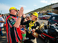 Jul 22, 2018; Morrison, CO, USA; NHRA top fuel driver Leah Pritchett celebrates with Don Corsette after winning the Mile High Nationals at Bandimere Speedway. Mandatory Credit: Mark J. Rebilas-USA TODAY Sports