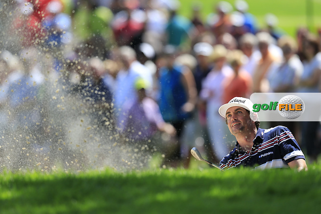 Keegan Bradley (USA) chips from a bunker at the 9th green during Saturday's Round 3 of the 2013 Bridgestone Invitational WGC tournament held at the Firestone Country Club, Akron, Ohio. 3rd August 2013.<br /> Picture: Eoin Clarke www.golffile.ie