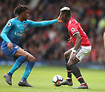 Alex Iwobi of Arsenal catches Paul Pogba of Manchester United in the face during the premier league match at the Old Trafford Stadium, Manchester. Picture date 29th April 2018. Picture credit should read: Simon Bellis/Sportimage