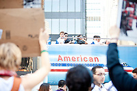 "A tourist bus passes the protest ""Occupy Wall Street"" which continues into its third week in Zuccotti Park in New York City on October 8, 2011."