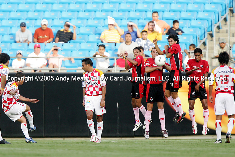 Juan Pablo Rodriguez (l) of Tecos sees his free kick bounce off the Atlas wall on Sunday, July 17, 2005, at Bank of America Stadium in Charlotte, North Carolina. U.A.G. Tecos defeated Atlas (both of the Mexican soccer league) 1-0 in a preseason game.