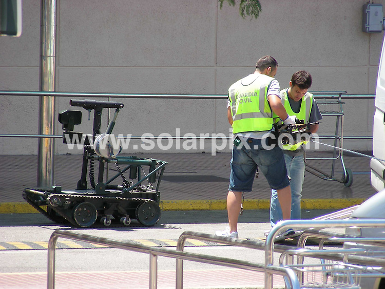 **ALL ROUND EXCLUSIVE PICTURES FROM SOLARPIX.COM**.**NO PUBLICATION IN SPAIN**.British holiday makers were evacuated at Ibiza airport today after a suspect package was found. The Spanish police reacted quickly and brought in a robot to effect a controlled explosion. This follows the high terrorist alert in London this weekend and the Spanish ETA promise of a terror campaign on the costas..JOB REF: 4180         MAD       DATE:30.06.07.**MUST CREDIT SOLARPIX.COM OR DOUBLE FEE WILL BE CHARGED* *UNDER NO CIRCUMSTANCES IS THIS IMAGE TO BE REPRODUCED FOR ANY ONLINE EDITION WITHOUT PRIOR PERMISSION*