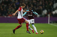 West Ham United's Arthur Masuaku and West Bromwich Albion's Craig Dawson<br /> <br /> Photographer Rob Newell/CameraSport<br /> <br /> The Premier League - West Ham United v West Bromwich Albion - Tuesday 2nd January 2018 - London Stadium - London<br /> <br /> World Copyright &copy; 2018 CameraSport. All rights reserved. 43 Linden Ave. Countesthorpe. Leicester. England. LE8 5PG - Tel: +44 (0) 116 277 4147 - admin@camerasport.com - www.camerasport.com