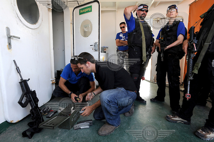 Instructors and trainees prepare for a drill, during a training course to fight maritime terror and piracy, on a boat in Haifa Port....
