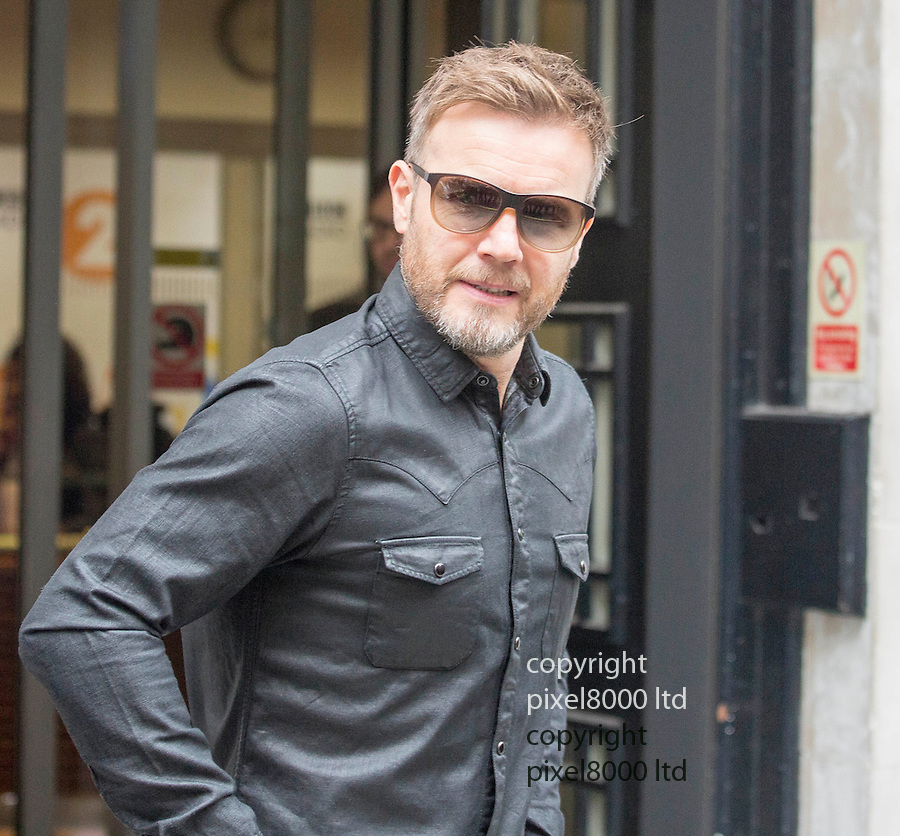 Pic shows: Take That leave at BBC Radio studios today for the launch of their new single  16.10.15<br /> <br /> Gary Barlow with fans poses for selfies<br /> <br /> <br /> Pic by Gavin Rodgers/Pixel 8000 Ltd