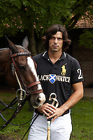 Nacho Figueras in his Black Watch strip with one of his polo ponies