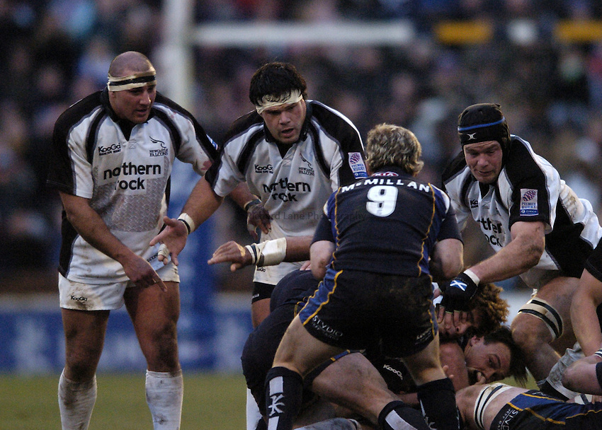 Photo. Jed Wee..Leeds Tykes v Newcastle Falcons, Zurich Premiership, 27/12/2004..Newcastle's Andy Long, Marius Hurter and Cory Harris (L to R).