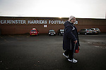 An elderly woman walking towards Aggborough, home of Kidderminster Harriers pictured before they played visitors Gainsborough Trinity in a National League North fixture. Harriers were formed in 1886 and have played at their current home since 1890. They won this match  by 3-0 watched by a crowd of 1465.