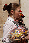 Israel, Jerusalem. An Ultra Orthodox Jewish girl in costume carrying ?Mishlo?ach Mnot? (Purim gifts) on Purim holiday at the Me?a She?arim quarter, 2005<br />