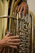 Lee MacDowell practices with his new tuba inside the Tuba Exchange, Durham, N.C.