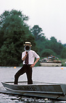 Henley Royal Regatta, Henley on Thames, Oxfordshire, England. 1980s Man with megaphone giving instructions to the racing rowers.