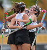 Garden City No. 20 Jennifer Medjid, right, gives No. 9 Devon Heaney a congratulatory hug after she scored a goal at the end of the first half of the Nassau County varsity field hockey Class B final against Manhasset at Adelphi University on Sunday, November 1, 2015. Garden City won by a score of 9-0.<br /> <br /> James Escher