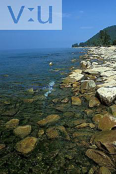 Shallow water and rocky shore of Lake Baikal, Siberia, Russia
