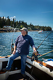 USA, Alaska, Ketchikan, Captain Tony tends to his lines while fishing the Behm Canal near Clarence Straight, Knudsen Cove along the Tongass Narrows
