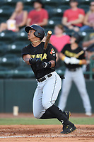Julio Rodriguez (44) of the West Virginia Power follows through on his swing during a game against the Hickory Crawdads at L.P. Frans Stadium on July 25, 2019 in Hickory, North Carolina. The Power defeated the Crawdads 3-2. (Tracy Proffitt/Four Seam Images)