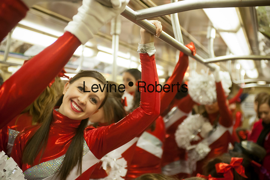 Members of the Varsity Spirit cheerleading team, travel back to their buses via the subway after leading the 86th Annual Macy's Thanksgiving Day parade in New York on Thursday, November 22, 2012. The team is comprised of elite cheerleaders from around the country. (© Richard B. Levine)