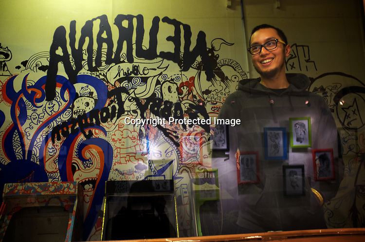 26 year old Filipino underground artist, Gabriel Joseph Saldana (Dino) poses for a photo at the Vinyl on Vinyl gallery at The Collective in Makati, Manila in Philippines. Photo: Sanjit Das
