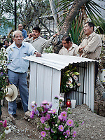 Men visit the cemetery in Teotitlan del Valle during Easter processions in April 2012...Photo by Matt Nager