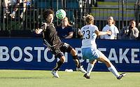 Eriko Arakawa (30) kicks out the ball against Nikki Krzysik (23). FC Gold Pride tied the Chicago Red Stars 1-1 at Buck Shaw Stadium in Santa Clara, California on June 7th, 2009.