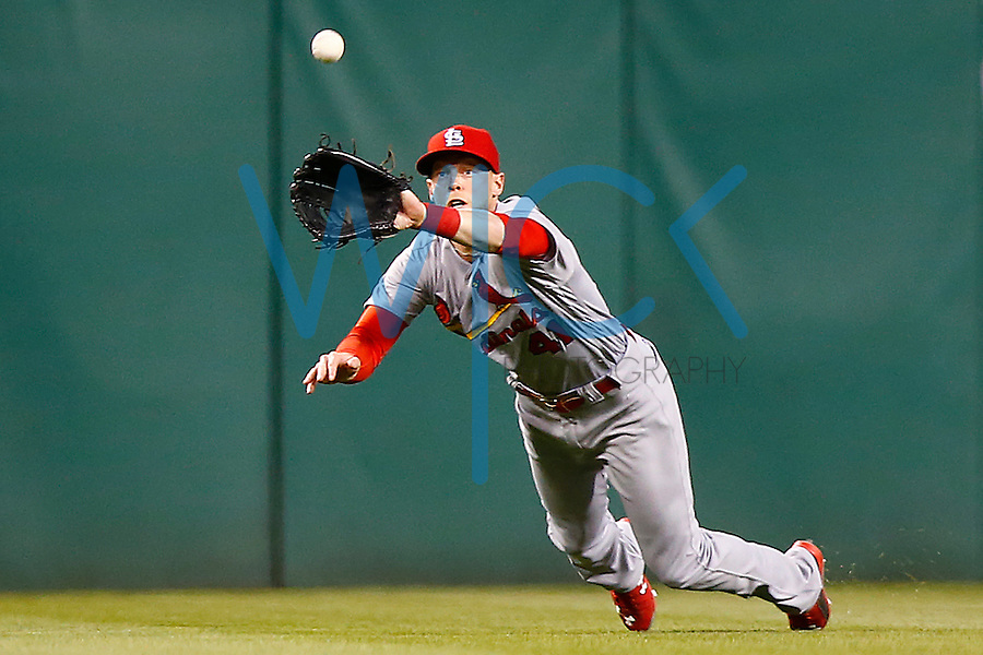 Jeremy Hazelbaker #41 of the St. Louis Cardinals catches a fly ball against the Pittsburgh Pirates during the game at PNC Park in Pittsburgh, Pennsylvania on April 6, 2016. (Photo by Jared Wickerham / DKPS)