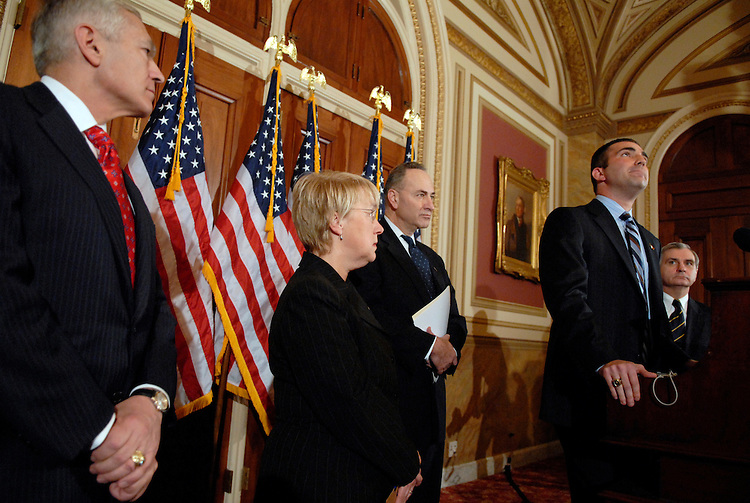 Jon Soltz, Iraq war veteran, contemplates a question about the future of U.S. involvement there, at a news conference to call on President Bush to announce a new plan to bring the was in Iraq to a close.  Also attending from left are, Gen. Wesley Clark, Sens. Patty Murray, D-Wash., Chuck Schumer, Soltz, and Sen. Jack Reed, D-R.I.,