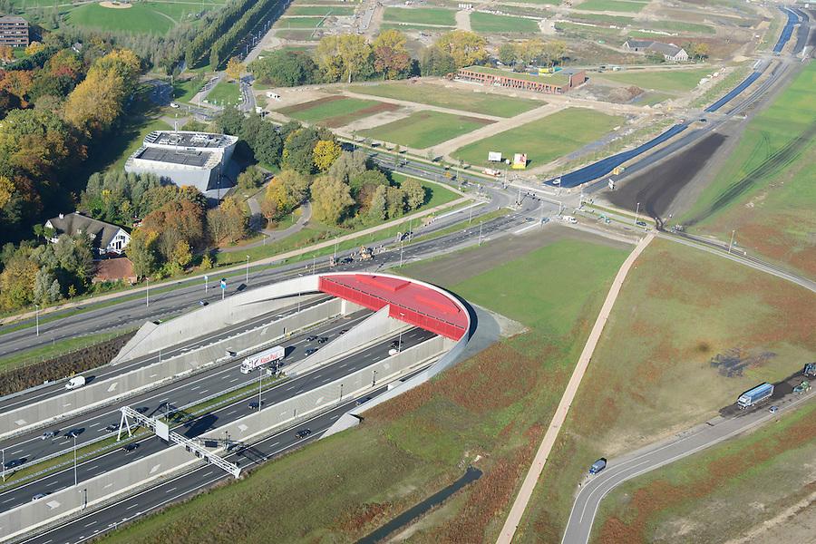 Nederland, Utrecht, Utrecht, 24-10-2013;<br /> Rijksweg A2 en de zuidelijke ingang van de  Leidsche Rijntunnel, een landtunnel die de verkeersoverlast, luchtvervuiling en geluidsoverlast voor Utrecht en de Vinexwijk Leidsche Rijn moet verminderen. Stadsbaan links van de tunnel. Stadsbaan links van de tunnel.<br /> Roadway A2 and the southern entrance to the tunnel Leidsche Rijn, a landtunnel built to decrease the nuisance of traffic noise and air pollution for the city of Utrecht and the suburb Leidsche Rijn (l) . <br /> luchtfoto (toeslag op standaard tarieven);<br /> aerial photo (additional fee required);<br /> copyright foto/photo Siebe Swart.