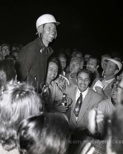 John Fitch (in helmet) and co-driver Phil Walters (just to the right of Fitch, also holding a beer) after winning the 1953 Sebring 12 hour race for Cunningham