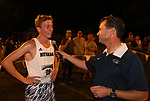 Jared Marchegger is interviewed by announcer Donny Nelson after running for the Nevada Men's Cross Country team as they compete for the first time in 25 years in the Bonanza Casino Nevada Twilight Classic season opener at Mira Loma Park in Reno on Friday night, August 30, 2019.