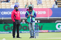 Making sure the zing bails are in working order during Australia vs England, ICC World Cup Semi-Final Cricket at Edgbaston Stadium on 11th July 2019